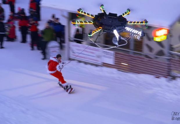 Гигантски дрон с 16 ротора влачи Дядо Коледа. На сноуборд. Нереално видео и галерия